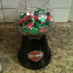 I made a Harley Davidson candy bowl! Easy to make. Fish bowl, glue gun, spray paint, flower pot, and a sticker of your choice.....add your favorite candy!
