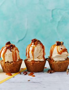 Salted caramel ice cream pecan cookie cups - Somewhere between a cookie and a blondie, these cookie cups make the perfect container for indulgent salted caramel ice cream