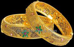Image from http://1.bp.blogspot.com/-NTTw46U_HWo/Up7drDW0rBI/AAAAAAAAarg/Sp7YAjiesuQ/s1600/kalyan-jewellers-gold-filigree-bangles.jpg.
