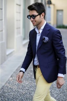 Shop this look for $163:  http://lookastic.com/men/looks/blazer-and-longsleeve-shirt-and-pocket-square-and-chinos-and-belt/222  — Navy Blazer  — Blue Longsleeve Shirt  — Navy Polka Dot Pocket Square  — Yellow Chinos  — Brown Leather Belt
