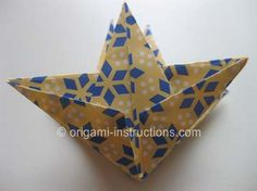 This is an elegant origami 8 pointed star that is perfect for the top of your origami christmas tree. Find out how to fold this beautiful origami star here. Origami Paper Art, Diy Origami, Paper Crafts, Origami 8 Pointed Star, Origami Stars, Origami Christmas Tree, Christmas Crafts, Christmas Ornaments, Origami Ornaments
