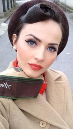 40's makeup- red lip and a bright blush. Blush was a bid trend during this decade