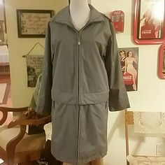 Gorgeous Raincoat- Sz Small Beautiful raincoat with zip off bottom  ....can also be worn as jacket....see pics for details....Size small....Color is smoky blue....Has a small spot on front but not.noticeable... Travelsmith Jackets & Coats Trench Coats