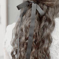 Octavia let Winn do her hair once. She carefully tied a complimenting black bow, making O feel like a little girl again. A wave of nostalgia slammed against her.