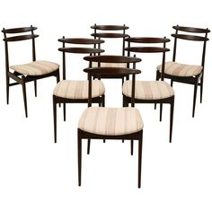 Set of 6 Italian Teak Dining Chairs attributed to Vittorio Dassi | From a unique collection of antique and modern dining room chairs at https://www.1stdibs.com/furniture/seating/dining-room-chairs/