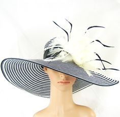 Derby Hat,Black and White Kentucky Derby Hat,Wide Brim Hat with Feathers. $59.97, via Etsy.