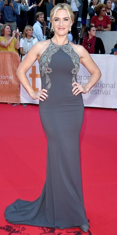 At the TIFF premiere of The Dressmaker, Kate Winslet showed off her killer curves in a body-hugging charcoal-colored Badgley Mishka gown with an embellished bodice.