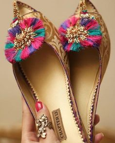 Golden and folkloric shoes