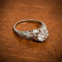A rare Edwardian Engagement Ring adorned with diamonds, filigree and milgrain.