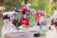 I love this combination of the darker red and purple with the minty green succulents. - wedding flower center piece with succulents