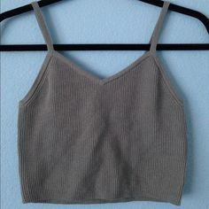 Olive green crop tank top New with tags. Thick supportive material. No adjustable straps. Not Brandy. Olive green color, the pictures make it look grey but it's green Brandy Melville Tops Crop Tops