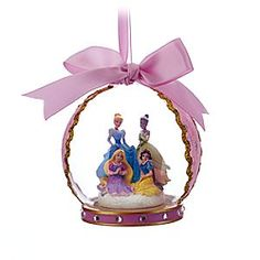 Disney Princess Glass Globe Ornament - Pink | Disney Store Four tiny figural princesses are showcased inside a glamorous glass globe with stardusted satin ribbon and ric rac decoration. They'll have a ball all season long hanging from your holiday tree.