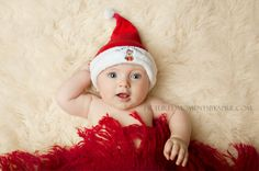 4 month old baby boy with my first Christmas Santa hat