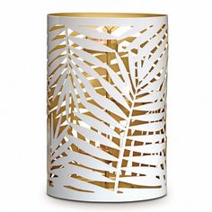 "Gilded Palm Hurricane. Grand palm leaf hurricane adds an elegant, tropical touch to your summertime décor. Gold-colored interior enhances the magical light and shadow effect. Made of metal. Holds jars, pillars, or use tealights with included tealight tree. All candles sold separately. 8¾""h; 6""w.  Item #:  P92184"