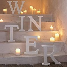 Palette: Winter Whites - Love the stair stepped letters surrounded by candles