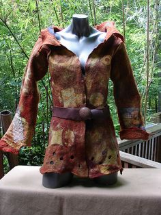 Steampunk Felt Jacket    Wet felted from Merino fleece, with incorporated scraps of hand dyed silk from a pre-owned shirt then resist dyed.