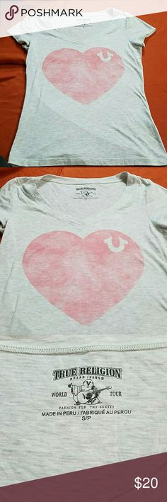 Like new true religion v neck t-shirt Like new true religion v neck t-shirt has sun faded look on heart which its supposed too. Size small gray and pink True Religion Tops