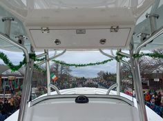 Had a blast throwing beads aboard the @regulatormarine/Suffolk Marine float in the Montauk Friends of Erin St Patrick's Day Parade today! A different view from the helm of a Regulator...down Main St Montauk! Happy St Patty's Day! . #montauk #mainstreet #parade #regulatormarine #regulator #regulator34 #mtk #stpattysday #newyork #offshorelife #offshore by gaelingoexplore