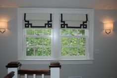 Lovely Roman blinds with a Greek Key designed trim in a French grosgrain ribbon in Charcoal by Samuel & Sons.