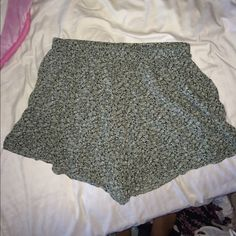 Brandy flow shorts Green flower flow shorts from brandy Melville! Worn them once and there in almost perfect condition. There is one small string hanging from the bottom of shorts(: Brandy Melville Shorts
