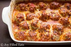 Meatball Parm Casserole - Low Carb, Keto, Grain and Gluten Free, THM S - If you need a new family dinner this should be it. Flavorful meatballs baked until golden & then covered with tomato sauce & cheese. Meatball Casserole, Keto Casserole, Casserole Recipes, Meatball Bake, Turkey Casserole, Meatball Subs, Meatball Recipes, Low Carb Keto, Low Carb Recipes