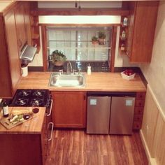 california-tiny-houses-sequoia-004 - brilliant to see full and functional kitchen in a tiny house. Space in bathroom for washer/dryer too