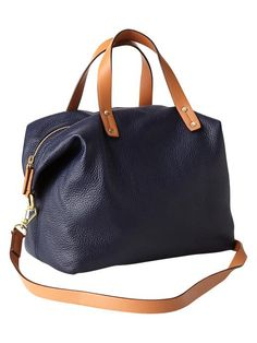 This is an example of the bag I am looking for. Leather or nylon, tote or satchel, handles and cross body strap. No pleather. Manmade materials would be okay on the straps only. No bling or fringe. Lightweight. Navy is best, dark colors ok, no black, white, tan or light colors.