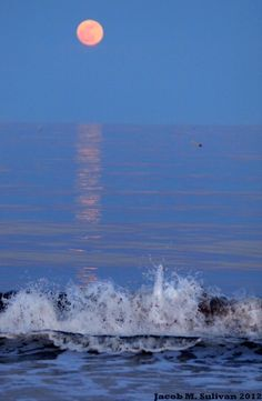 Another moon shot, but with a focus on the light it casts off the water, plus some layering with the waves crashing against the coast.