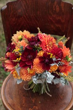 October bridal bouquet with oxblood and burnt orange dahlias.
