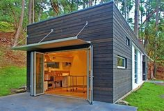 backyard studio - this is the style of building I want under the deck - I love the bifold doors at the front