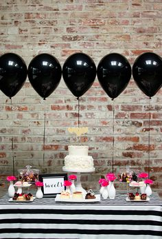 This pink and black dessert table calls to me. I'm a total sucker for anything black and white... Glossy black balloons, striped table cloth, hot pink flowers... Perfection. Side note... Isn't there a Goo Goo Dolls song about a black balloon? Now I get it. =)