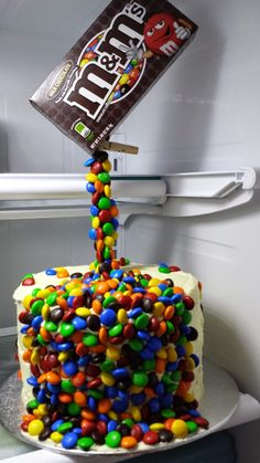 Anti-gravity M & M's cake :)  Evan wants chocolate cake with Peanut butter icing.  This might make it more special for his birthday.