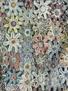 Interlocking hand crocheted flowery shapes in wool. From Sophie Digard. 12 x 52 inches.