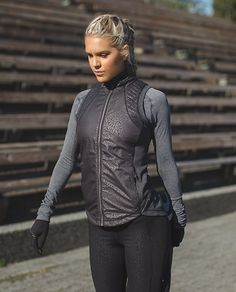 Rebel Runner Vest | We designed this run vest to keep us covered when we hit the streets in rebellious weather. We layer it over our long sleeve shirt to keep our core cozy when we hit the ground running. Reflective details help us shine bright in low light, so no matter when the mood strikes we're good to go.