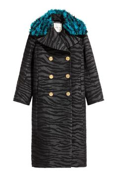 Long wool-blend coat: KENZO x H&M. Long, double-breasted coat in a textured, tiger-striped wool blend with a detachable extra collar in faux fur. Wide notch lapels, gold-coloured buttons down the front and at the cuffs and concealed, diagonal front pockets. Lined.