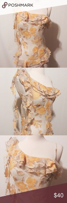 "Fabulous Italian Design Yellow Chiffon Top Crinkle organza with yellow and tan burnout floral print. This unique blouse is a work of art!!! Featuring asymmetrical neckline, with one adjustable lingerie strap, ruffle details on bodice and on hem, , free-flowing cascading ruffle on one shoulder. This garment has no closures and is a slip on. Bias cut for great fit.    Best fit a USA size 0-2  100% poly  Dry Clean   32"" bust  26"" overall length- long  23"" overall length-short  Made in Paris…"