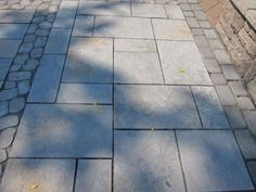 Designing With Concrete Pavers - Yes! These are pavers, not bluestone! The installed price is not that different, but if you are a DIY, they are easier to lay. Love the look. You can even add paver mosaics for a very creative design. Made my Techo-Bloc