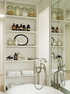 another vintage styled linen closet shelf with apothacary jars...An Urban Cottage