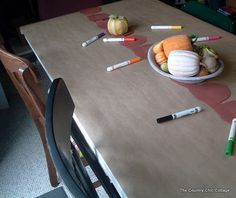 Thanksgiving table covered with craft paper.