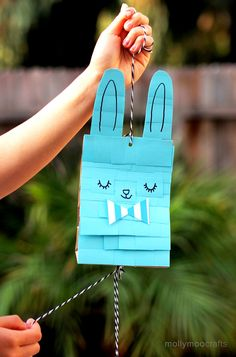 Easter Bunny Craft Paper Bag Pinata - post-it notes never looked so cute! // MollyMooCrafts.com