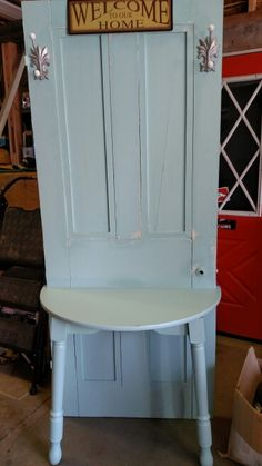 Repurposed door and table into Hall Tree $125.  34 inch wood door painted light blue and sealed.
