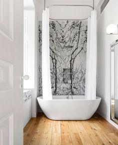 Minimalism Meets Pink Marble & Heritage Tiles at NANA Apartment in Lisbon by rar.studio.
