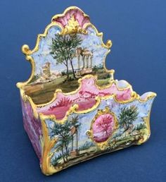 Elaborately moulded faience letter holder in Roccoco style, France 1880