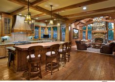 Open floor plans prevail in the lakeside home · Traditional lakeside home interior