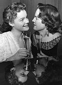Schneider, Romy, 23.9.1938 - 29.5.1982, German actress, portrait, with mother Magda Schneider, drinking sparkling - Stock Photo