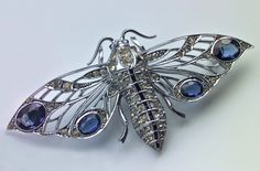 WEIR & SONS Art Deco Moth Brooch Silver Chromed Faux Diamond Faux Sapphire H: cm in) W: cm in) Marks: 'WB' & 'Sterling' Irish, Literature: Original fitted case the silk marked: EstD Weir & Sons, (Dublin) Ltd 96 Grafton St, & 3 Wicklow St, Dublin Art Nouveau Jewelry, Jewelry Art, Jewelry Accessories, Jewelry Design, Jewellery, Antique Brooches, Antique Jewelry, Vintage Jewelry, Butterfly Fashion