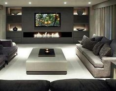 My exact idea for mancave!  This is what I meant by electric wall fireplace w/flat screen above it!  Probably different colors however.
