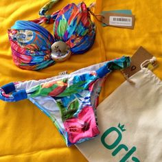 Hot Brazilian Bikini Set ☀️ Made of durable lycra material and padding.  colors won't fade for years, tie closure in back, tag is large but will fit medium better. comes with a cute pouch. Orla Swim Bikinis