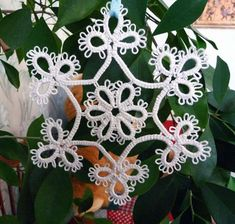 White snowflakes Star tatting. This snowflake never melt on your Christmas tree