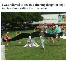 Man was relieved when his daughter wanted to ride the mustache was just a see-saw ride in the park.